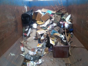 dumpster at wet building